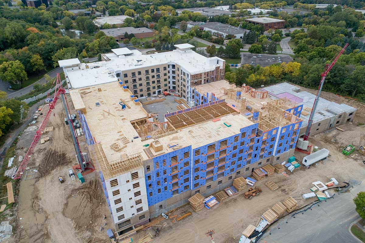 Aerial view of building being framed